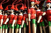 stock photo of fable  - Details of many colorful wooden Pinocchios for sale - JPG