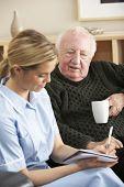 image of visitation  - Nurse visiting senior man at home - JPG