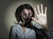 picture of shock awe  - Young woman victim of domestic violence and abuse - JPG