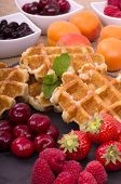 image of fruit platter  - A pile of Belgian Waffles and fresh summer fruits with a sprig of mint - JPG
