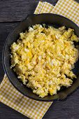 pic of scrambled eggs  - scrambled eggs in vintage frying iron pan overhead view - JPG
