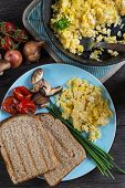 image of scrambled eggs  - serving healthy brunch scrambled egg with vegetables from above - JPG