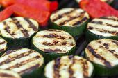 picture of zucchini  - Zucchini and red pepper on a bbq grill - JPG
