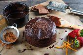 stock photo of tort  - homemade chocolate torte cake on baking paper - JPG