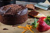foto of tort  - homemade chocolate torte cake on baking paper - JPG