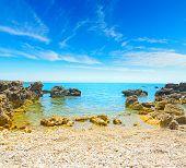 picture of shoreline  - pebbles and rocks in Alghero shoreline Sardinia - JPG