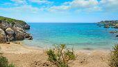 stock photo of shoreline  - a small beach in Alghero shoreline Sardinia - JPG