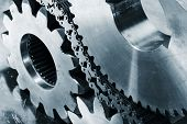stock photo of cogwheel  - cogwheels and gears powered by large chains - JPG