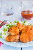 stock photo of thighs  - Chicken thighs marinated and baked in Russian dressing sauce served with rice and peas  - JPG