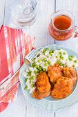 image of thighs  - Chicken thighs marinated and baked in Russian dressing sauce served with rice and peas - JPG