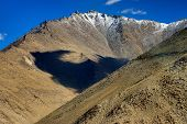 pic of jammu kashmir  - Rocky landscape of with blue sky and ice peaks brown stones and rocks at Changla pass Leh Ladakh Jammu and Kashmir India - JPG