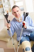 picture of crutch  - Man with leg in neck brace - JPG