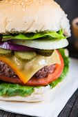 stock photo of burger  - closeup pub style burger on wooden table - JPG