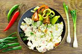 stock photo of scrambled eggs  - Omelette scrambled eggs with vegetables onions peppers and tomatoes - JPG