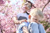pic of brother sister  - Children sitting under a blooming tree - JPG