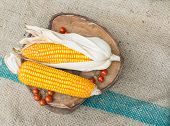stock photo of corn-silk  - Dry brown corn and mini tomato - JPG