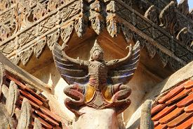 picture of garuda  - Garuda on the roof  at the belfry in Thai temple - JPG