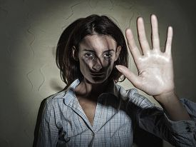 stock photo of shock awe  - Young woman victim of domestic violence and abuse - JPG