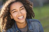 Outdoor portrait of beautiful happy mixed race African American girl teenager female young woman smi poster
