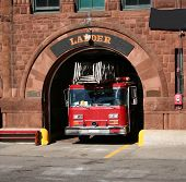 stock photo of fire truck  - american fire truck leaving fire station boston - JPG