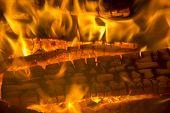 burning firewood coal closeup in the fireplace. Fire fireplace ember wood home Embers closeup. Glowi poster