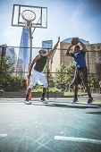 Basketball Player Playing Outdoors poster