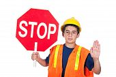 picture of hands up  - A young man holds up a stop sign together with a hand signal to stop - JPG