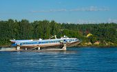 picture of hydrofoil  - The passenger boat on hydrofoils going down the river on a summer day - JPG