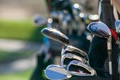 Golf Clubs Glistening In The Sunlight. A Golf Bag Full Of Clubs. Golf Club Heads. poster
