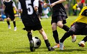 Soccer Players Competing For The Ball. Primary School Football Game. Soccer Tackle. Youth Soccer Tea poster