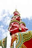 image of brahma  - Face Of Red Brahma Statue In Thai Art Style with sky - JPG