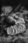 Black And White Image. Ginger Sliced Slices On The Kitchen Board, Close Up. Rustic Style. poster