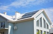 White Clay Tiled Roof And Solar Panels, Solar Water Heating For House Energy Efficiency. Modern Hous poster