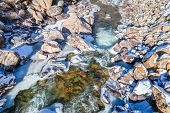 Постер, плакат: partially frozen mountain river Cache la Poudre in northern Colorado aerial view