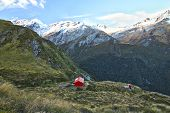 Liverpool Hut Rests On The Edge Of A Large Cliff With Mt. Aspiring In The Distance. Matukituki Valle poster