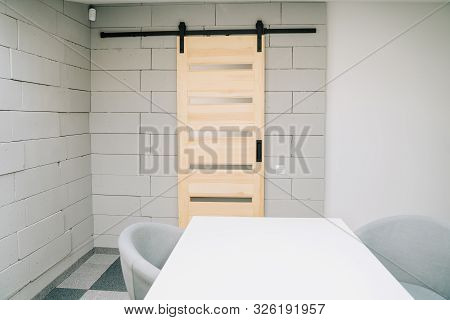 poster of Sliding Barn Door On Foam Brick Wall And Furniture Element Of Meeting Room Conceptual Cozy Interior