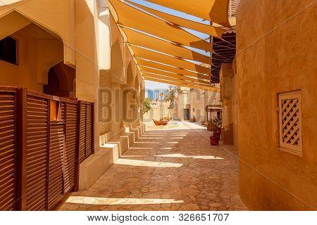 poster of Old Dubai. Traditional Arabic Streets In Historical Al Fahidi District, Al Bastakiya. Dubai, United