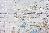 foto of arriere-plan  - A white roughly textured brick wall painted with white paint - JPG