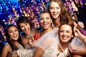 image of hen party  - Group shot of young women celebrating their friend - JPG