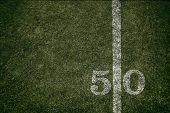 American Football Field Fifty Yard Line Background Image Grass And Turf Inside A Stadium poster