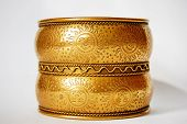 stock photo of dowry  - Round Indian bracelet with the picture of sun - JPG