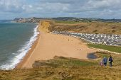 Coast Path Freshwater Bay Dorset Uk Towards West Bay With Walkers poster