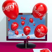 stock photo of apologize  - Sorry Balloons From Computer Shows Online Apology Regret Or Remorse - JPG