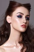 Portrait Of A Beautiful Young Model With Professional Makeup, Trendy Colorful Smoky Eyes And Wavy Ha poster