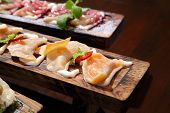 Dumplings With Potato In Sour Cream On A Wooden Board.  Dumplings With Mushrooms. Dumplings With Che poster