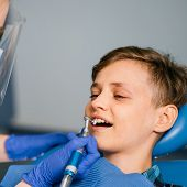 Pediatric Dentistry, Prevention Dentistry, Oral Hygiene Concept. Mechanical Teeth Cleaning, Dentist  poster