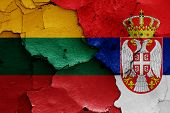 Flags Of Lithuania And Serbia Painted On Cracked Wall poster
