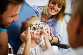 Ophthalmologist, Optometrist Checking Child Vision Looking For Problems And Caring For Eye poster