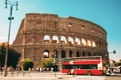 Rome, Italy. Colosseum. Red Hop On Hop Off Touristic Bus For Sightseeing In Street Near Flavian Amph poster