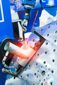 Robotic Welding Machine in a Metal Manufacturing Plant poster